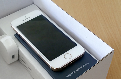 iPhone in a white factory box